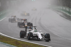 Felipe Massa, Williams FW38 Mercedes, leads Daniil Kvyat, Toro Rosso STR11, and Carlos Sainz Jr, Tor