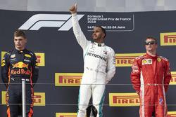 Max Verstappen, Red Bull Racing, 2nd position, Lewis Hamilton, Mercedes AMG F1, 1st position, and Kimi Raikkonen, Ferrari, 3rd position, on the podium