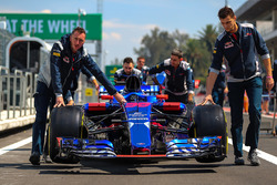 The car of Brendon Hartley, Scuderia Toro Rosso STR12 is pushed down pitlane by mechanics