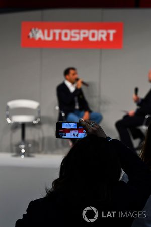 Fans film Marc Gene speaking to Henry Hope-Frost on the Autosport Stage