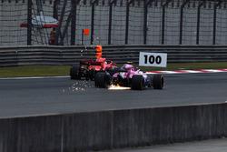 Esteban Ocon, Force India VJM11 sparks and Sebastian Vettel, Ferrari SF71H