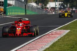 Sebastian Vettel, Ferrari SF71H, leads Nico Hulkenberg, Renault Sport F1 Team R.S. 18