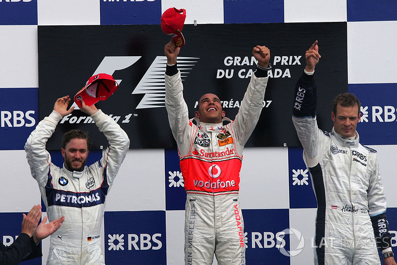 Podium: race winner Lewis Hamilton, McLaren, second place Nick Heidfeld, BMW Sauber F1, third place