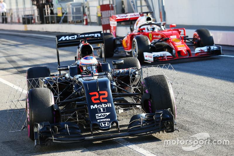 Jenson Button, McLaren MP4-31 with sensor equipment as Sebastian Vettel, Ferrari SF16-H running the Halo cockpit cover leaves the pits