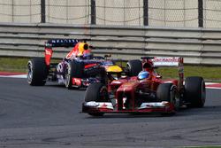 Fernando Alonso, Ferrari F138 and Sebastian Vettel, Red Bull Racing RB9