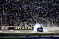 Brett Moffitt, Hattori Racing Enterprises, AISIN Atlanta Toyota Tundra celebrates with a burn out