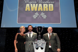 Martin Truex Jr., Furniture Row Racing, and girlfriend Sherry Pollex on stage after accepting the Myers Brothers Award