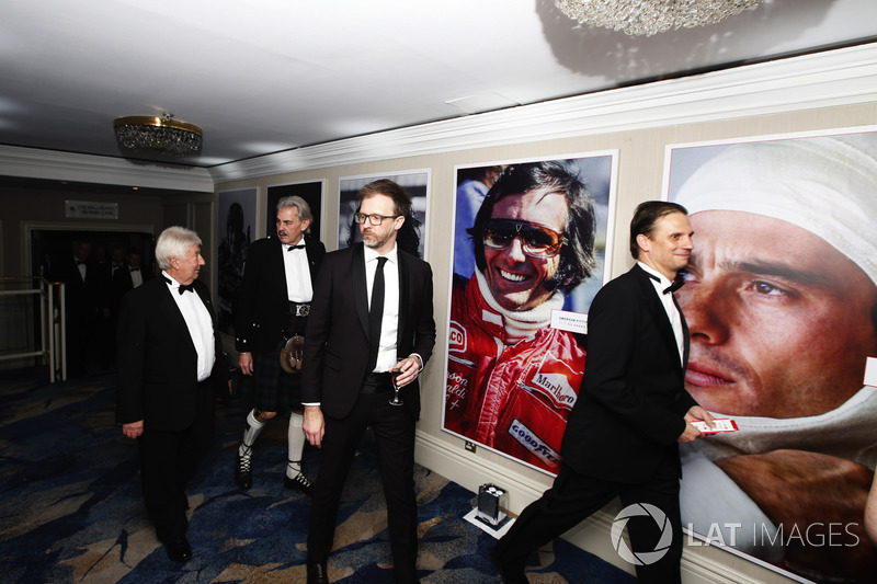 Guests, including Herbie Blash and Gordon Murray, walk through the Champions' Corridor Gallery