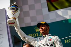 Lewis Hamilton, Mercedes AMG F1. Celebrates on the podium with his trophy