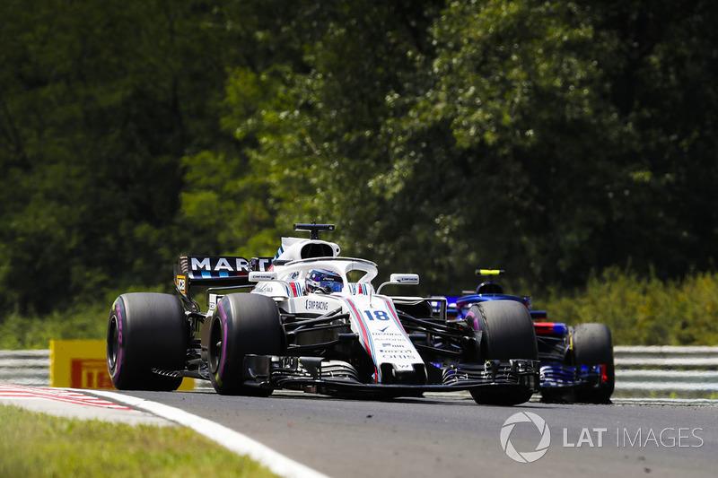 Lance Stroll, Williams FW41, leads Pierre Gasly, Toro Rosso STR13