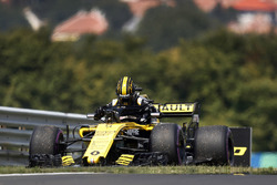 Nico Hulkenberg, Renault Sport F1 Team R.S. 18, climbs from his car after stopping on track