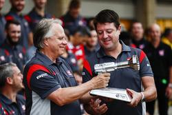 Wheel gun trophy presented by Gene Haas, Team Owner, Haas F1 Team