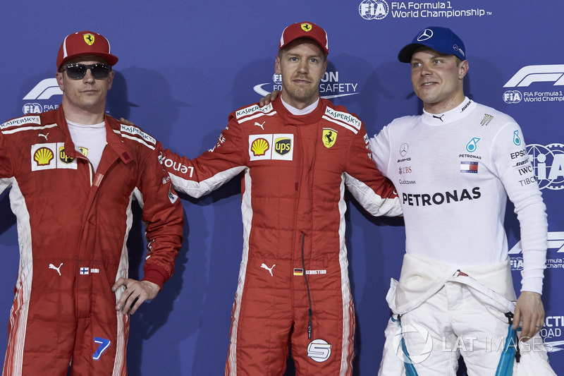 Sıralama turları ilk üç: Sebastian Vettel, Ferrari, Kimi Raikkonen, Ferrari, Valtteri Bottas, Mercedes AMG F1