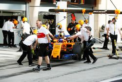Fernando Alonso, McLaren MCL33 Renault, is returned to the garage by engineers