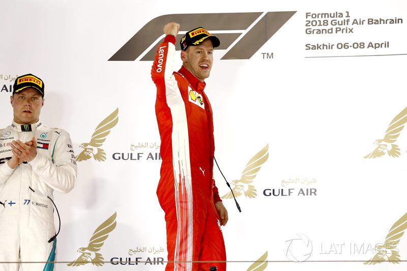 Valtteri Bottas, Mercedes AMG F1, 2nd position, applauds as Sebastian Vettel, Ferrari, 1st position, celebrates on the podium