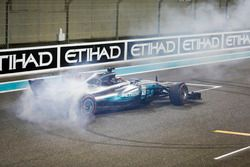 Second place Lewis Hamilton, Mercedes AMG F1, celebrate with doughnuts