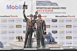#77 Compass Racing, Audi RS3 LMS TCR, TCR: Britt Casey Jr, Tom Long celebrates the win on the podium