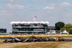 Kevin Magnussen, Haas F1 Team VF-18, lidera a Carlos Sainz Jr., Renault Sport F1 Team R.S. 18, y Pierre Gasly, Toro Rosso STR13