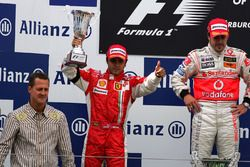 Podium: first place Fernando Alonso, McLaren, second place Felipe Massa, Ferrari, Michael Schumacher