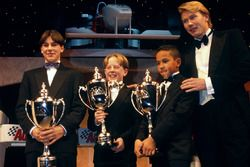 Mika Hakkinen presents to Gary Paffett, Tom Sisley and Lewis Hamilton