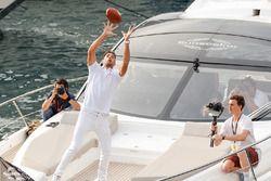 Daniel Ricciardo, Red Bull Racing catches an American football from Tom Brady
