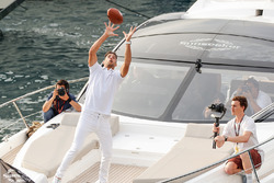 Daniel Ricciardo, Red Bull Racing catches an American football from Tom Brady