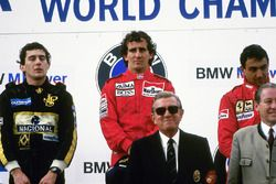 Podium: race winner Alain Prost, McLaren, second place Ayrton Senna, Lotus, third place Michele Albo