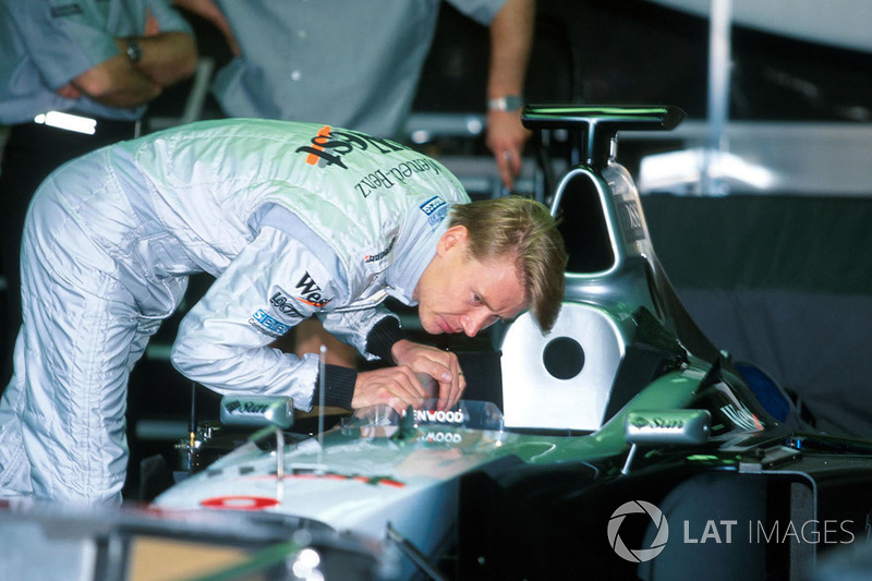 Race winner Mika Hakkinen,McLaren checks his cockpit