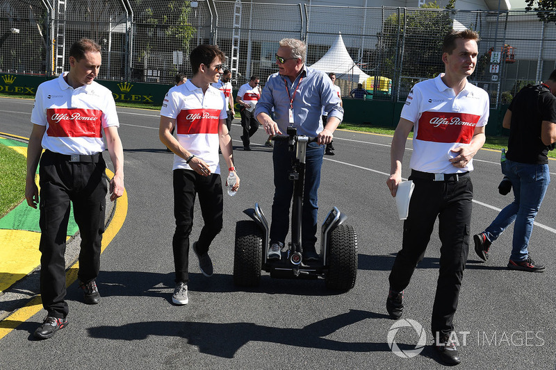 Charles Leclerc, Alfa Romeo Sauber F1 Team walks the track and talks with Johnny Herbert, Sky TV