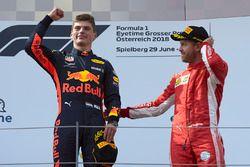 Max Verstappen, Red Bull Racing, 1st position, and Sebastian Vettel, Ferrari, 3rd position, celebrate on the podium
