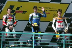 Podium: second place Randy De Puniet, Race winner Dani Pedrosa, third place Sebastián Porto