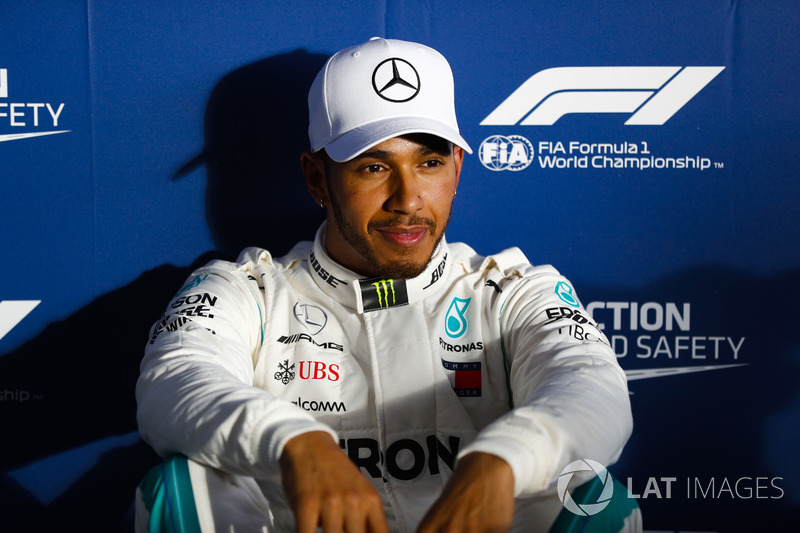 Lewis Hamilton, Mercedes AMG F1, relaxes after setting pole position