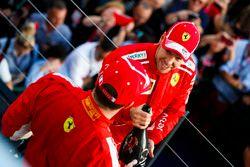 Race winner Sebastian Vettel, Ferrari, and thiod place Kimi Raikkonen, Ferrari celebrate on the podi