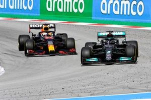 Lewis Hamilton, Mercedes W12 and Max Verstappen, Red Bull Racing RB16B battle