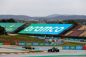 Sir Lewis Hamilton, Mercedes W12, leads Max Verstappen, Red Bull Racing RB16B, and Valtteri Bottas, Mercedes W12