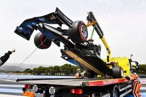 The damaged car of Yuki Tsunoda, AlphaTauri AT02, is loaded onto a truck