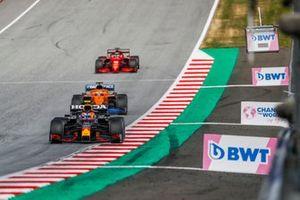 Sergio Perez, Red Bull Racing RB16B , Daniel Ricciardo, McLaren MCL35M, and Charles Leclerc, Ferrari SF21