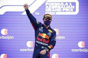 Sergio Perez, Red Bull Racing, 1st position, celebrates on the podium