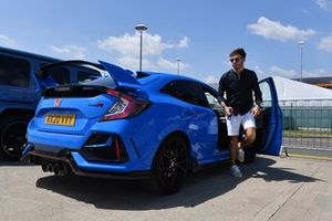 Pierre Gasly, AlphaTauri, arrives in a Honda Civic Type R