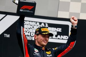 Max Verstappen, Red Bull Racing, 1st position, on the podium with his trophy