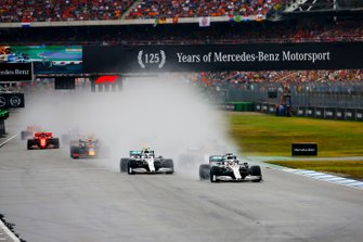 Lewis Hamilton, Mercedes AMG F1 W10, leads Valtteri Bottas, Mercedes AMG W10, Carlos Sainz Jr., McLaren MCL34, Max Verstappen, Red Bull Racing RB15, and the rest of the field