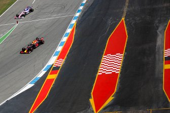 Pierre Gasly, Red Bull Racing RB15, leads Sergio Perez, Racing Point RP19
