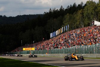 Lando Norris, McLaren MCL34, leads Kevin Magnussen, Haas F1 Team VF-19 and Romain Grosjean, Haas F1 Team VF-19