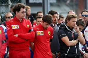 Mattia Binotto, Team Principal Ferrari, and Charles Leclerc, Ferrari, stand on the grid for the memorial of Anthoine Hubert