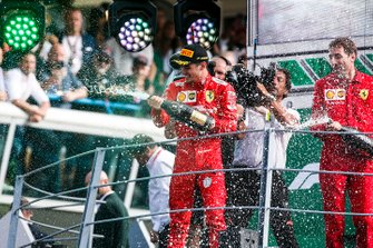 Charles Leclerc, Ferrari, 1st position, sprays the Champagne