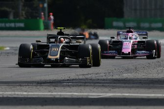 Kevin Magnussen, Haas F1 Team VF-19, leads Sergio Perez, Racing Point RP19