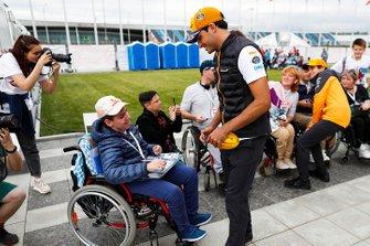 Carlos Sainz Jr., McLaren, and Lando Norris, McLaren, meet fans