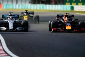 Lewis Hamilton, Mercedes AMG F1 W10, battles with Max Verstappen, Red Bull Racing RB15