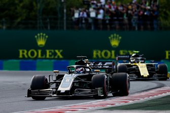 Romain Grosjean, Haas F1 Team VF-19, leads Nico Hulkenberg, Renault F1 Team R.S. 19