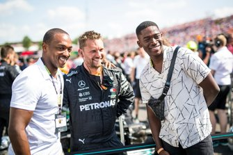 Actor Anthony Mackie on the grid with a Mercedes mechanic